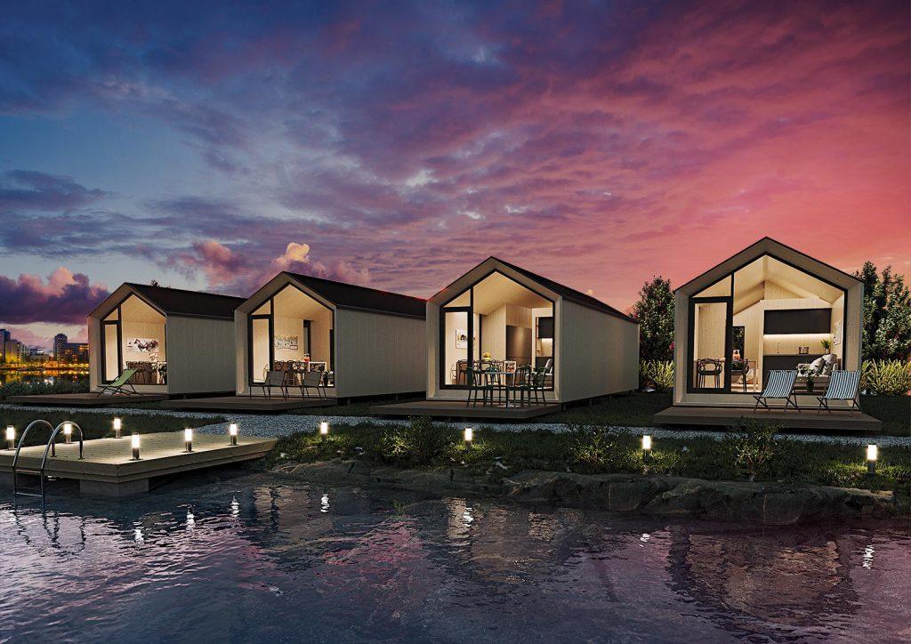 Fyra Vuolas hus vid en sjö.